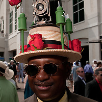 A Chicago hatmaker who changes hat themes every year. This year, his hat is a tribute to the Derby photographers. A 1915 Kodak completes this years work.