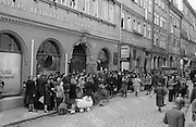German civilians wait ina long line to buy bread shortly after Americans took over the town. April 1945.