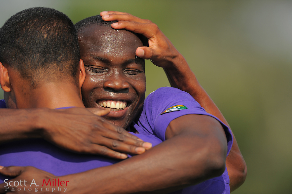 Charlotte Eagles forward Darryl Roberts (9) celebrates with Sean Reynolds (21) after scoring during Orlando's game against the Ocala Stampede at the Seminole Soccer Complex Saturday on May 26, 2012 in Sanford, Fla. ...©2012 Scott A. Miller..