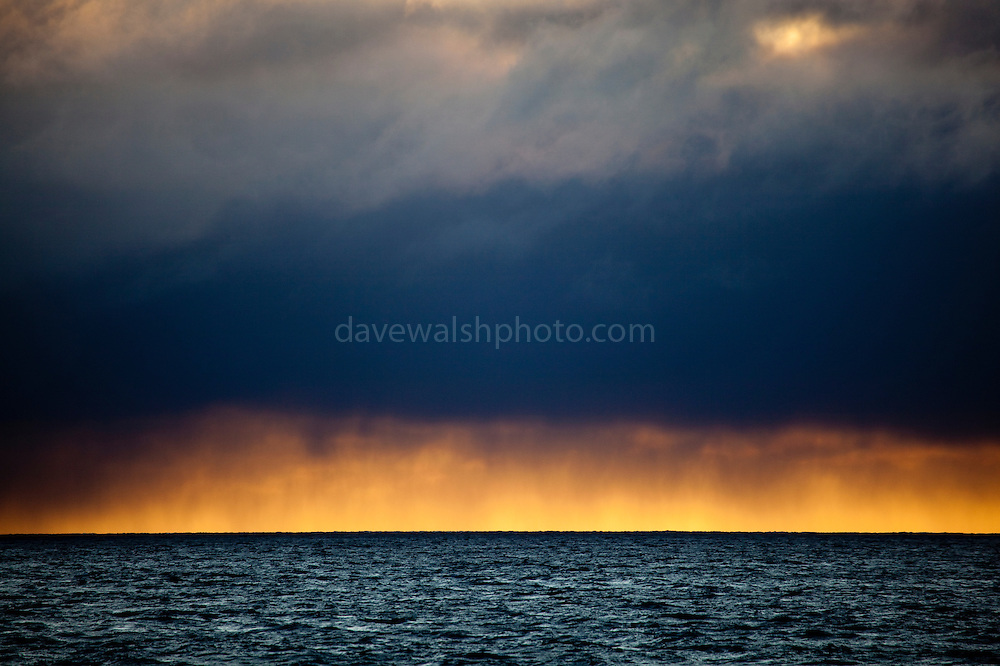 Snowing on the sunset at the mouth of Isfjord, Svalbard
