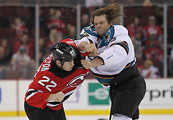 Oct 21; Newark, NJ, USA; New Jersey Devils left wing Eric Boulton (22) and San Jose Sharks defenseman Douglas Murray (3) fight during the first period at the Prudential Center.