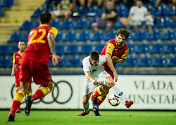 Miha Zajc of Slovenia vs Boris Kopitovic of Montenegro during friendly football match between National Teams of Montenegro and Slovenia, on June 2, 2018 in Stadium Pod goricom, Podgorica, Montenegro. Photo by Vid Ponikvar / Sportida