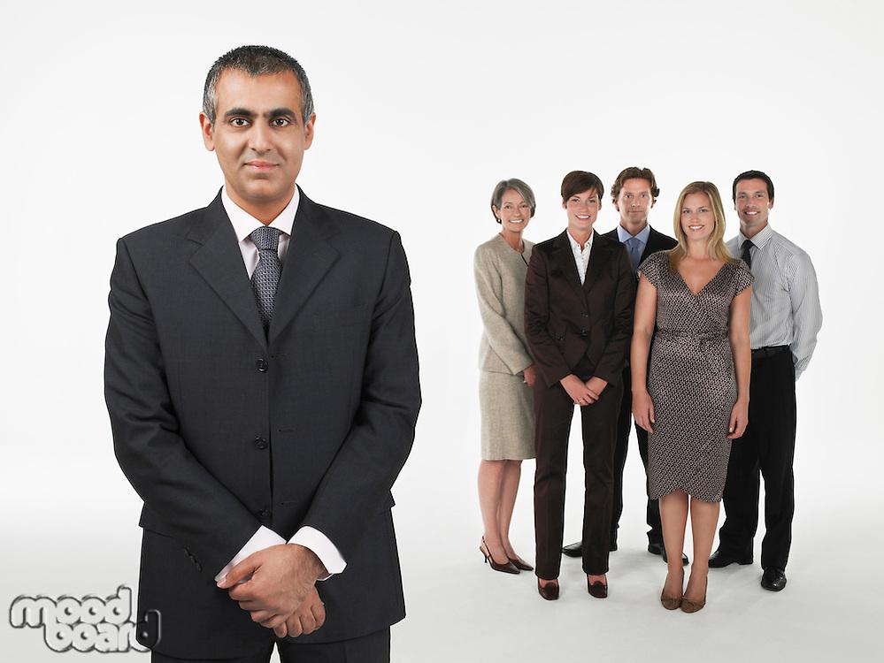 Proud Businessman group behind