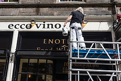 Edinburgh, Scotland, UK. 3 July, 2020. Shops and businesses are re-opening and getting back to normal in Scotland after coronavirus lockdown on such businesses were relaxed this week. Man painting exterior of bar in Old Town. Opening date for pubs and bars not certain at the moment.  Iain Masterton/Alamy Live News