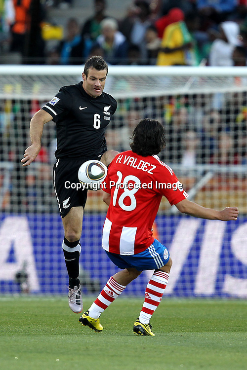 Ryan Nelsen of New Zealand and Nelson Valdez of Paraguay  during the the FIFA World Cup 2010 match between New Zealand and Paraguay held at The Peter Mokaba Stadium in Polokwane, South Africa on the 24th June 2010<br /> <br /> <br /> Photo by Ron Gaunt/SPORTZPICS