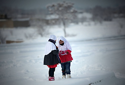 60873938<br /> Afghan girls talk to each other on the snow in Kabul, capital of Afghanistan on December 30, 2013. The first snow of this winter visited the Afghan capital on Monday. , 30th December 2013. Picture by imago / i-Images<br /> UK ONLY