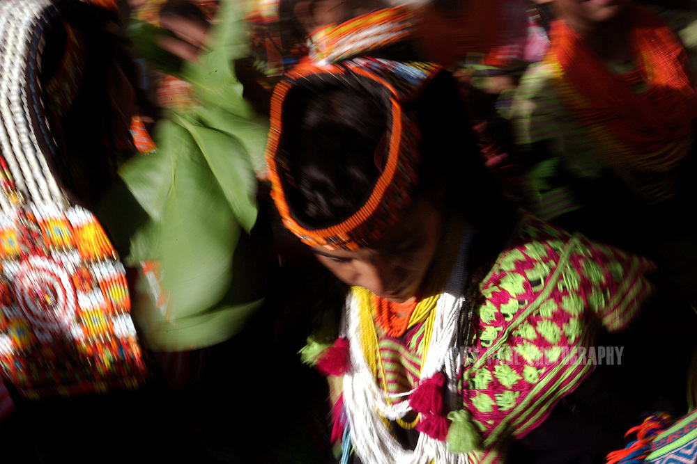 "KALASHA VALLEYS, PAKISTAN - MAY 16: Kalash women and girls sing and dance in a fevered finale to the ""Joshi"" (spring) festival in the village of Batrik May 16, 2008 in the Kalasha Valleys, northwestern Pakistan. The Joshi Festival is a celebration of dance, music and prayer to welcome the coming of warmer season and the new life and crops it brings. The shrinking Kalash community of 4000, who claim to be descendants of Alexander the Great and worship several gods, are considered by many Pakistanis to be unclean, lazy and heretics. They often face ridicule and persecution for their polytheistic religion and fear the spread of hard-line Islamism bordering their communities. (Photo by Warrick Page)"