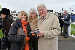 Left to right, INGRID SEWARD, JILLY COOPER and LAURIE BRENNAN at the 2015 Hennessy Gold Cup held at Newbury Racecourse, Berkshire on 28th November 2015.