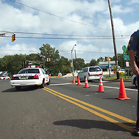 (PAGE1) Keansburg 9/19/2003 Cpl. Mark Uptegrove and Sgt Leo Armenti secure a traffic light without power at the corner of Hwy 36 and Laural Ave. .  Michael J. Treola Staff Photographer....MJT