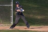 Goshen, New York - A John S. Burke Catholic player hits the ball during a varsity baseball game on April 21, 2014.