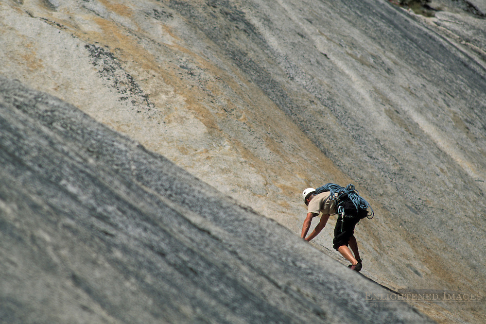 Mountain rock climber climbing on granite wall of Polly Dome, Yosemite National Park, California