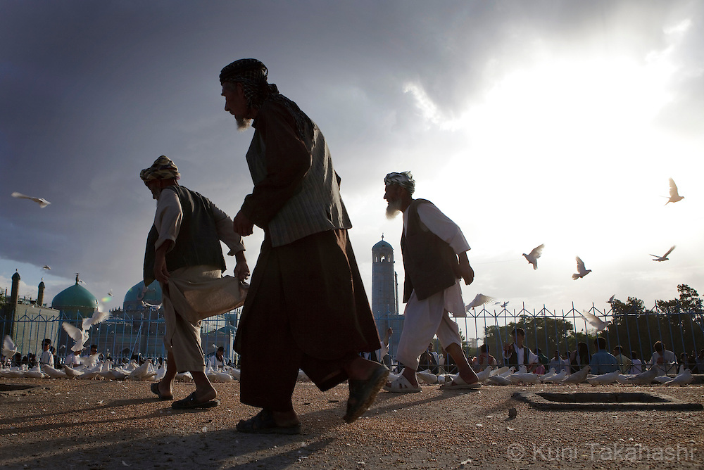 ( Mazar-i-Sharif, Afghanistan - May 11, 2012).Old men walk as Shrine of Hazrat Ali or the Blue Mosque is seen in background in Mazar-i-Sharif in Afghanistan on May 11, 2012. The historical mosque attracts thousands of pilgrims each year. .(Photo by Kuni Takahashi)