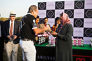 Her Highness Rajmata Padmini Devi of the Jaipur Royal family (right) presents a trophy to Greg Johnson, the captain of the Western Australia Polo Team after a close match for the Argyle Pink Diamond Cup, organised as part of the 2013 Oz Fest in the Rajasthan Polo Club grounds in Jaipur, Rajasthan, India on 10th January 2013. Photo by Suzanne Lee
