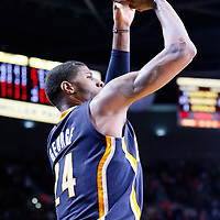 02 December 2013: Indiana Pacers small forward Paul George (24) takes a three point jumpshot during the Portland Trail Blazers 106-102 victory over the Indiana Pacers at the Moda Center, Portland, Oregon, USA.
