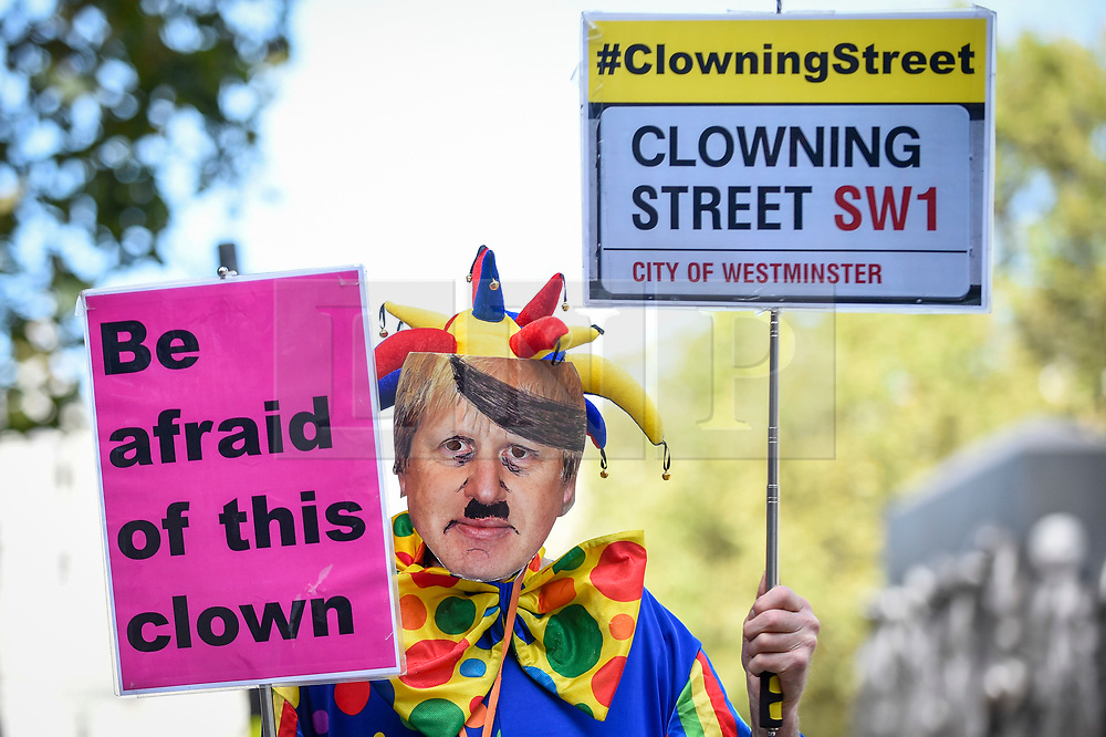 © Licensed to London News Pictures. 29/08/2019. LONDON, UK.  An anti-Brexit campaigner dressed as Boris Johnson as a clovn protests outside Downing Street.  The protest takes place the day after Boris Johnson, Britain's Prime Minister, announced the intention to suspend Parliament, under the mechanism of prorogation, in order to refine his Brexit plans.  Photo credit: Stephen Chung/LNP