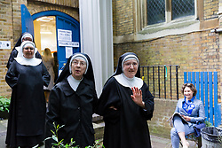 © Licensed to London News Pictures. 08/06/2017. LONDON, UK.  Nuns arrive to vote in the general election at a polling station in St John's Hyde Park in London this morning.  Photo credit: Vickie Flores/LNP
