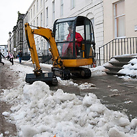 Perth Snow & Ice Clear Up...11.01.10<br /> A digger working on the pavement on Rose Terrace in Perth to break up the solid ice<br /> Picture by Graeme Hart.<br /> Copyright Perthshire Picture Agency<br /> Tel: 01738 623350  Mobile: 07990 594431