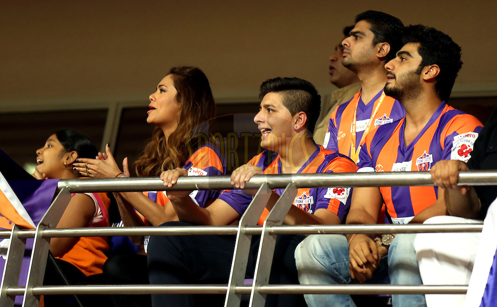 Actor Arjun Kapoor(R TO L), Kartik Wadhawan owner of FC Pune city  and Actor Easha Gupta during match 17 of the Hero Indian Super League between FC Pune City and Kerala Blasters FC held at the Shree Shiv Chhatrapati Sports Complex Stadium, Pune, India on the 30th October 2014.<br /> <br /> Photo by:  Sandeep Shetty/ ISL/ SPORTZPICS