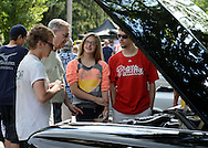 LANGHORNE, PA - JUNE 21:  From left, Andrew Hunt, 17 of Plainsboro, New Jersey shows off his father's 1962 Cadillac to Brian Shipley, Spencer Shipley, 21, and Claire Shipley, 14 of Langhorne, Pennsylvania during the Langhorne Classic Car Show June 21, 2014 in Langhorne, Pennsylvania.   Teams of cancer survivors and other participants walked around the school's track to raise money for cancer research. About 200 cars were on display at the 8th Annual event. (Photo by William Thomas Cain/Cain Images)