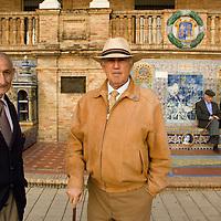 Senior citizen men at the Plaza de España, Sevilla, Andalucia, Spain. Seville, Andalusia, Spain.
