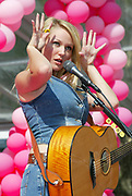 "NEW YORK - OCTOBER 30: Singer Jewel demonstrates the ""Model Blink"" at the 10th Anniversary of Pink Ribbon in Bryant Park October 1 2002 in New York City, New York.  (Photo by Matthew Peyton)"