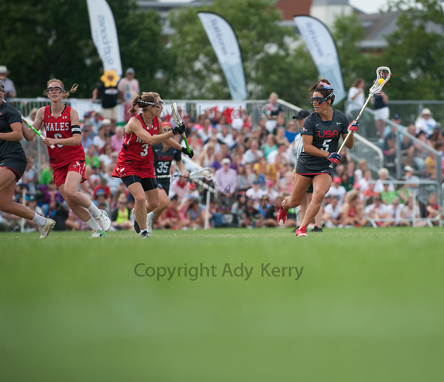 USA's Kelly Rabil  challenges with Wales' Emma Hawkins at the 2017 FIL Rathbones Women's Lacrosse World Cup, at Surrey Sports Park, Guildford, Surrey, UK, 18th July 2017.