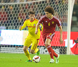 BRUSSELS, BELGIUM - Sunday, November 16, 2014: Wales' Joe Allen and Belgium's Axel Witsel during the UEFA Euro 2016 Qualifying Group B game at the King Baudouin [Heysel] Stadium. (Pic by David Rawcliffe/Propaganda)
