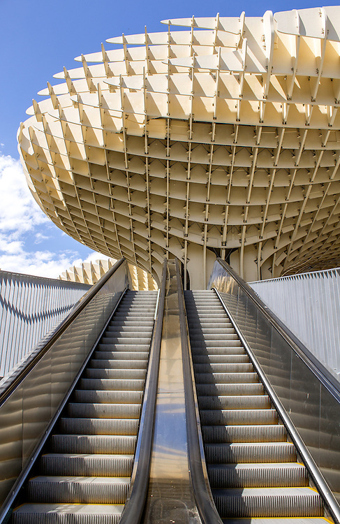 SEVILLE, SPAIN - MAY 2014: Metropol Parasol in Plaza de la Encarnacion on 31 of May 2014 in Sevilla,Spain. A new Seville Market Hall and attractive destination. Projected by J. Mayer H. architects, it is made from bonded timber with a polyurethane coating.