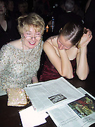 Ladies at the Party reading The New York Times Review of The La Boheme Play.Baz Luhrmann's Productions of Puccini's La Boheme Play Opening Post Party.Hudson Hotel .New York, NY, USA.December 08, 2002.Photo By Celebrityvibe.com/Photovibe.com..