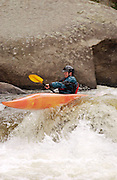Dion Bundy kayaks in the whitewater of the Narrows on the Poudre River, Colo., June 27, 2004.