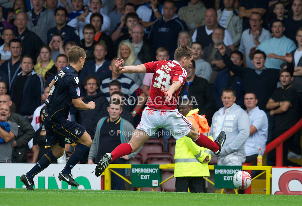 BRISTOL, ENGLAND - Saturday, August 7, 2010: Bristol City's Sam Vokes injures himself as he stretches for a ball in action against Millwall during the League Championship match at Ashton Gate. (Pic by: David Rawcliffe/Propaganda)