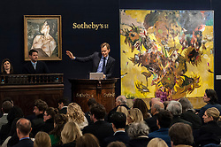 "© Licensed to London News Pictures. 10/02/2016. London, UK.  (L to R) Lucian Freud's ""Pregnant Girl"" and Adrian Ghenie's ""The Sunflowers"", which sold for a hammer price of £2.65m and £14.2m respectively, at Sotheby's Contemporary Art evening sale in New Bond Street.   Photo credit : Stephen Chung/LNP"