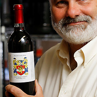 John D'Avella, of D'Avella Family Winery, pictured in his garage in Granger.<br />