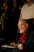 Arnold Hardy (cq) sits at The Spotted Dog--which used to house Fire Station 11--during a commemoration to mark the 60th anniversary of the Winecoff Hotel fire in downtown Atlanta. Hardy, who was a Georgia Tech student at the time, took a Pulizer Prize-winning photograph at the scene. The fire--at 119 deaths, the worst hotel fire in U.S. history--caused departments across the country to update their safety codes.