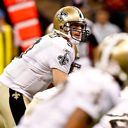 August 21, 2010; New Orleans, LA, USA; New Orleans Saints quarterback Drew Brees (9) under center during the first quarter of a preseason game against the Houston Texans at the Louisiana Superdome. Mandatory Credit: Derick E. Hingle