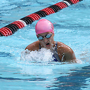 Swimmer Isabella Paoletti (12) competes in the 100 meter individual medley during the Summer Swim league championships finials Saturday, July. 17, 2015 at Western YMCA in Wilmington, DEL