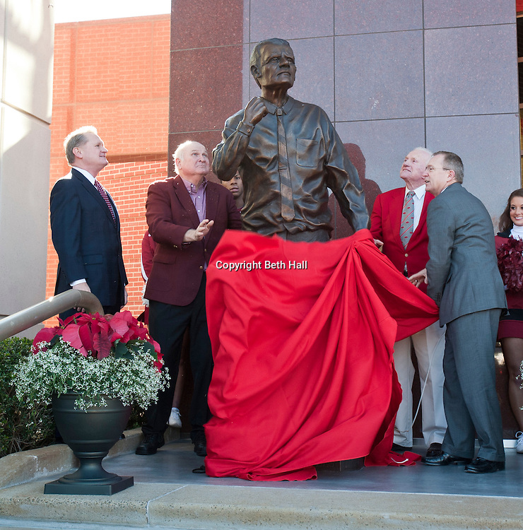 Nov 23, 2012; Fayetteville, AR, USA; University of Arkansas chancellor Dave Gearhart, former Razorback athlete Jim Lindsey,  former Arkansas Razorbacks head football coach and Athletic Director Frank Broyles and current AD Jeff Long unveil a statue of Broyles during a dedication ceremony before the start of a game against the Louisiana State Tigers at Donald W. Reynolds Stadium.  A seven and a half foot statue weighing more than 700 pounds was dedicated to Broyles who served the University of Arkansas for more than 50 years in his career. Mandatory Credit: Beth Hall-US PRESSWIRE