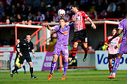 Plymouth Argyle's Jordan Houghton and Exeter City's Arron Davies during the Sky Bet League 2 match between Exeter City and Plymouth Argyle at St James' Park, Exeter, England on 2 April 2016. Photo by Graham Hunt.