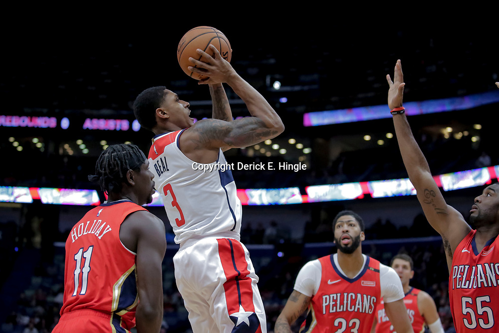 Nov 28, 2018; New Orleans, LA, USA; Washington Wizards guard Bradley Beal (3) shoots between New Orleans Pelicans guard Jrue Holiday (11) and forward Anthony Davis (23) and guard E'Twaun Moore (55) during the first quarter at the Smoothie King Center. Mandatory Credit: Derick E. Hingle-USA TODAY Sports