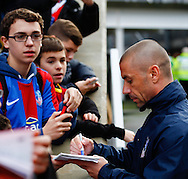 Picture by David Horn/Focus Images Ltd +44 7545 970036<br /> 09/11/2013<br /> Kevin Phillips of Crystal Palace signs autographs before the Barclays Premier League match at Selhurst Park, London.