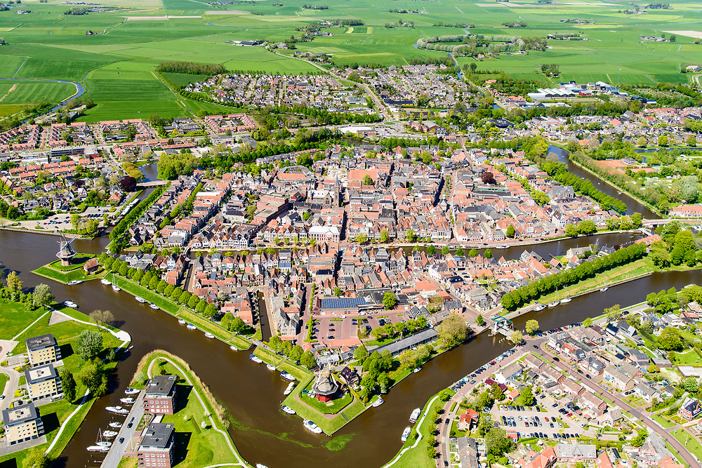 Nederland, Friesland, Gemeente Dongeradeel, 07-05-2018; overzicht Dokkum, met stadswallen en bolwerken, inclusief vestingmolens en bastions. Kleistreek met Waddenzee an de horizon.<br /> Overview Dokkum, with ramparts and strongholds, including city windmills and bastions.<br /> <br /> luchtfoto (toeslag op standaard tarieven);<br /> aerial photo (additional fee required);<br /> copyright foto/photo Siebe Swart