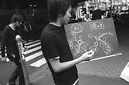 Man with a flow chart diagram in Shinjuku street, Tokyo, Japan