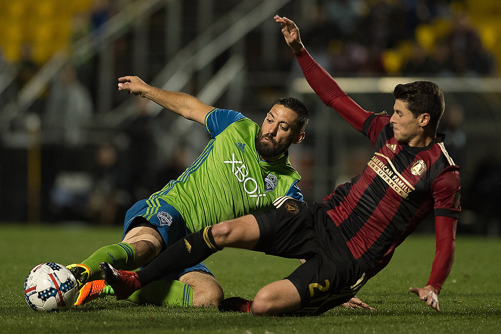 Seattle's Clint Dempsey (2) and Atlanta's Mark Bloom (21) fight for the ball. <br /> Seattle Sounders vs. Atlanta United FC at MUSC Health Stadium in Charleston, S.C. on Wednesday, Feb. 22, 2017.<br /> Zach Bland Photo