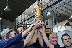 Italy, Paderno Dugnano - June 14, 2018.FIFA World Cup Trophy production at GDE Bertoni of Paderno Dugnano near Milan, Italy.Italian workers of the GDE Bertoni pose with the cup to be won in Russia. (Credit Image: © Calabrò/Fotogramma/Ropi via ZUMA Press)