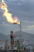 Hoover Schomberg of Santa Cruz California, makes music using jets of fire as precussion at the Burningman counter culture arts festival in the Black Rock Desert 100 miles north east of Reno, NV, Wednesday, Sept 1, 2004.
