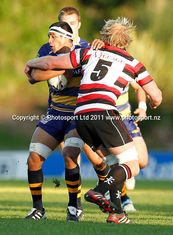 BOP Tanerau Latimer looks to beat the tackle of Counties captain Jamie Chipman. ITM Cup, Counties-Manukau Steelers v Bay of Plenty Steamers, Growers Stadium, Pukekohe, Sunday 17 July 2011 . Photo: Simon Watts / photosport.co.nz