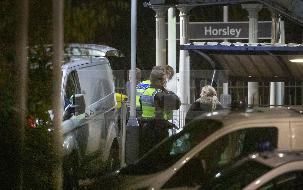 © Licensed to London News Pictures. 04/01/2019. Horsley, UK. A body is loaded onto a private ambulance at Horsley Railway station in Surrey where a man has been stabbed to death on a train. A murder investigation has been launched after the man was attacked while on board the 12. 58pm train service travelling between Guildford and London Waterloo. . Photo credit: Peter Macdiarmid/LNP