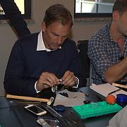 NLD/Amsterdam/20131003 -  Dad's moment , Ronald de Boer zet horloge in elkaar