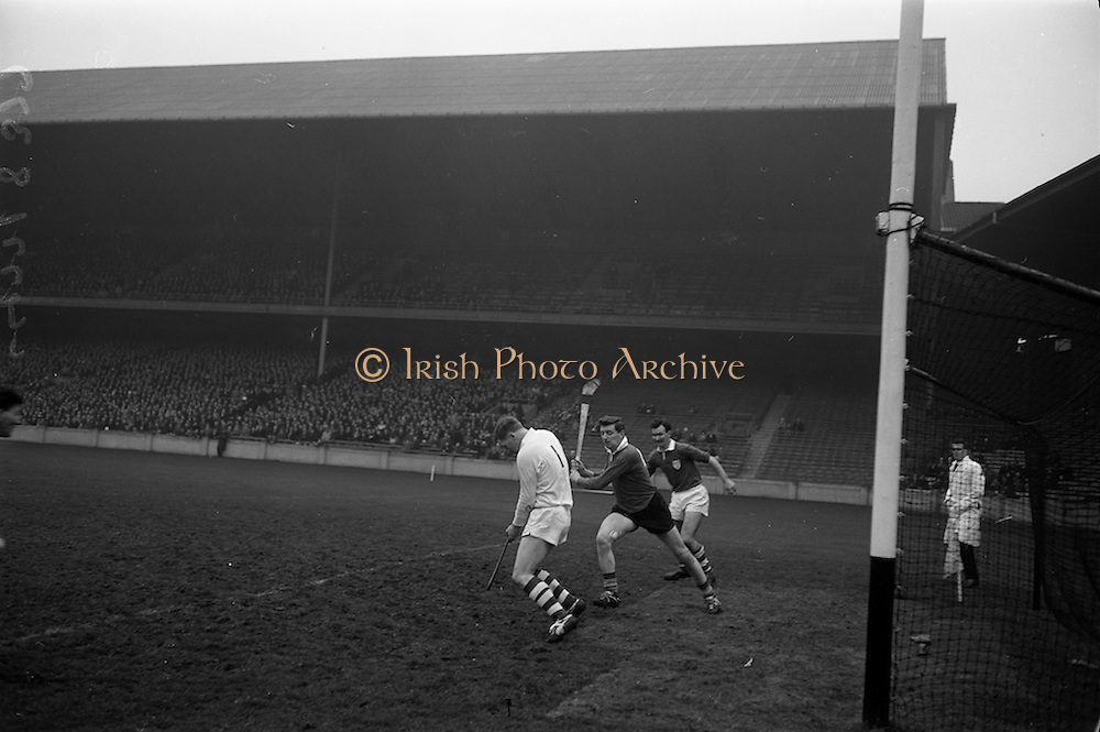 17/03/1965<br /> 03/17/1965<br /> 17 March 1965<br /> Railway Cup Hurling final  Munster v Leinster at Croke Park, Dublin. Ollie Walsh, Leinster keeper, brings off one of his spectactular saves. S. McLoughlin, (centre) Munster left full forward and T. Neville, Leinster right full back also in the picture.