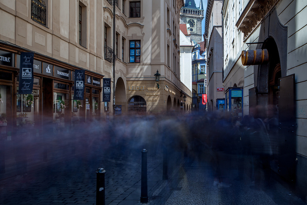 "Crowds walking through ""Melantrichova"" street toward the Old Town Square in Prague."